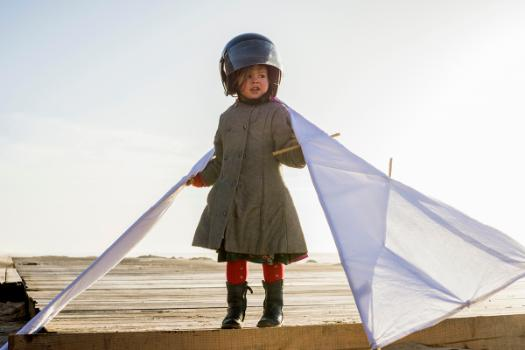 girl in helmet with wings