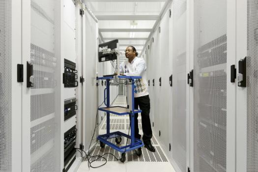 Man working in data server space