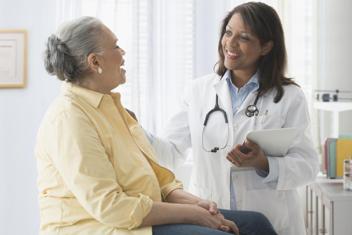 Female doctor assessing elderly patient