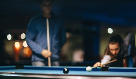 Two men playing pool strategic