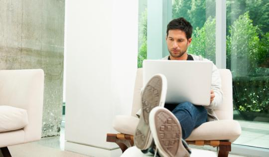 Man on laptop in living room